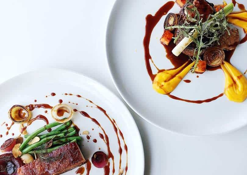 Fine dining food white plates